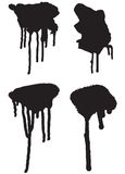 Spray drips 01. Four black spray or paint drips Royalty Free Stock Photography