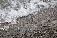 Spray durchgebrannt von den Wellen Stockfoto
