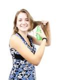 spray för brunettflickahår royaltyfri fotografi