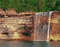 Spray Falls Munising Michigan. Spray falls in Munising Michigan on the pictured rocks coast line of Lake Superior Royalty Free Stock Photography