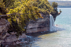 Spray Falls at Pictured Rocks National Lakeshore on Lake Superior. Spray Falls cascades over Pictured Rocks National Lakeshore and empties into Lake Superior, in stock photo