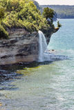 Spray Falls at Pictured Rocks National Lakeshore on Lake Superior. Spray Falls cascades over Pictured Rocks National Lakeshore and empties into Lake Superior, in stock image