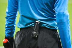 Spray foam on the belt at the referee Royalty Free Stock Photos