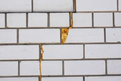 Spray Foam Insulation. Insulate wall cracks with foam caulking gun. Royalty Free Stock Photo