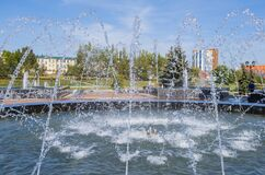 Spray fountain in the center of city with selective focus and blurred background. selective focus
