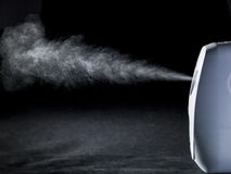 Spray in front of black background Royalty Free Stock Photos