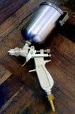 Spray gun. Camera shot on spray gun with wood background Stock Images