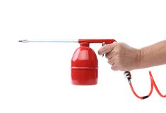 Spray gun and hand isolated Royalty Free Stock Images