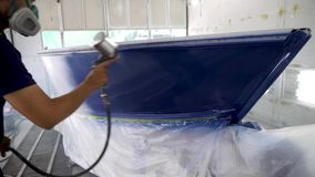 Spray gun with paint for painting a boat. Repairman fixing by painting boat body and painting boat using spray gun stock video footage