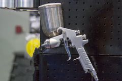 Spray gun for show with black background royalty free stock photography