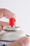 Spray i uppgift med finge på knappen Arkivfoton