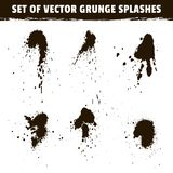Spray ink blots collection and grunge splashes. Spray ink blots collection. Set of vector grunge splashes of black paint isolated on white background Stock Photography