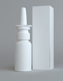 Spray nasal plastic bottle and tall paper box Royalty Free Stock Photo