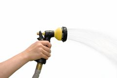 Spray Nozzle. Young hand holding a spraying hose nozzle Royalty Free Stock Photography