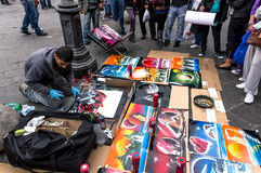 Spray paint artist. Selling his art on the streets of Florence, Italy Royalty Free Stock Photos