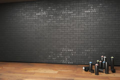 Spray paint bottle. Black spray paint bottle and blank brick wall, 3D Rendering Stock Photo