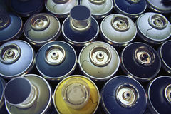 Spray paint cans,. Blue colors stock image