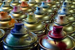 Used spray paint cans. Spray paint cans close up horizontal image royalty free stock photo