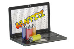 Spray paint cans and graffiti with laptop Royalty Free Stock Photo