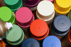 Spray paint cans. New spray paint cans. Top view royalty free stock photos
