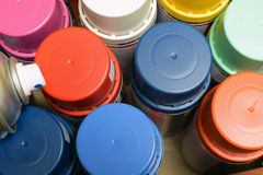 Spray paint cans. New spray paint cans. Top view royalty free stock photography
