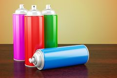Spray paint cans on the wooden table. 3D. Rendering Stock Photography