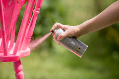 Spray paint an old chair pink Royalty Free Stock Image