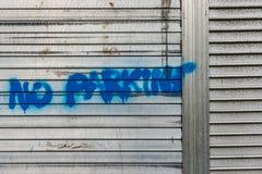 Spray painted no parking sign Stock Photos