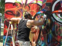 Spray Painting a Mural royalty free stock image