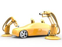 Spray painting robots. Industrial spray painting robots are operating in a car factory Royalty Free Stock Image