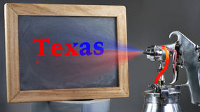 Spray Painting Texas. Air spray painting Texas blackboard sign Royalty Free Stock Images