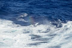 Spray rainbow of the Ocean Waves Royalty Free Stock Photo