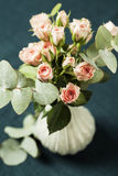 Spray roses. Bouquet of beautiful pink spray roses on dark background Stock Photography