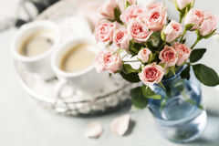 Spray roses. Romantic setup with coffee and roses in vase Stock Images