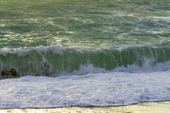 Spray of a sea wave twirling Stock Photos