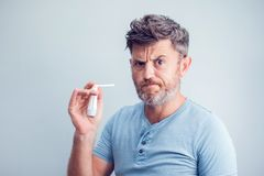 Spray for sore throat. Photo of a man who treats his throat with. A spray and sprinkles it in his mouth. The concept of health and disease Stock Photo