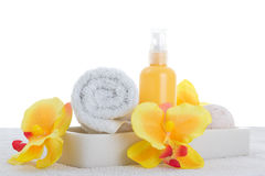 Spray, towel and yellow orchid Stock Photos