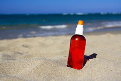 Spray tube with sun protection on beach Stock Images