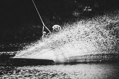 Spray water after extreme jump on board Royalty Free Stock Image