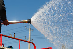 Spray water  during fire training in the industry. Spray water on truck  during fire training in the industry Royalty Free Stock Photos