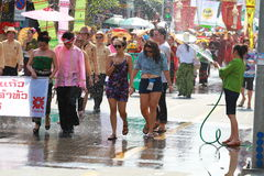 Spray water in Songkran festival. Thai woman spray water to tuorist and Songkran parade Stock Photos