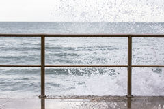 Spray on the waterfront in the storm Royalty Free Stock Photography