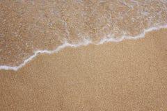 Spray. White spray on the beach Royalty Free Stock Images
