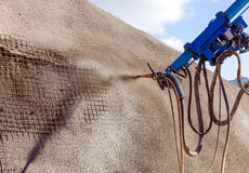 Sprayed concrete by machines Stock Photos