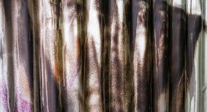 Sprayed corrugated iron. Detail of graffiti on corrugated iron. Sprayed by brown paint stock photo