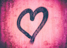 Sprayed heart on a pink wall background Stock Image