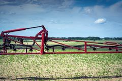 The sprayer bar before going out into the field to apply a herbicide, in order to protect young corn from the competition of weeds.  Stock Photography
