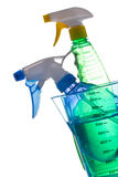 Sprayer bottles inside of measuring cup Stock Photography