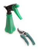 Sprayer and Clippers White Background. Gardening tools sprayer and clippers for pruning and insects on white background stock image