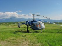 Sprayer Helicopter on the green field. Sprayer Helicopter on the field stock image